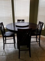 Solid wood five piece dining room set with lazy susan sold as is in The Woodlands, Texas