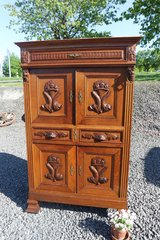 beautiful carved cabinet with fish ornament in Ansbach, Germany