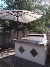 7 ft 5 burner outdoor kitchen with gas grill and mini fridge in Kingwood, Texas