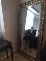 Tall mirror with leaf design and gold shimmer finish in Kingwood, Texas