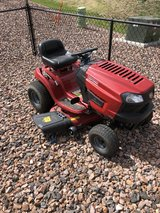 Driving Lawn Mower in Fort Carson, Colorado