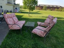 Outdoor patio set with cushions and coffee table in Fort Knox, Kentucky