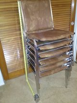 Stacking banquet chairs in MacDill AFB, FL