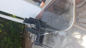 Glass patio table & chairs in Ramstein, Germany