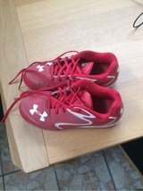 Youth Under Armour Soccer/Baseball Cleats w/ Shinguards in Ramstein, Germany