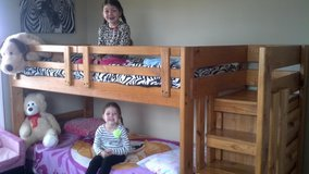 Bunk bed with mattresses and built in dresser under stairs in Fort Irwin, California