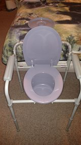 Portible commode. NEW in Bolingbrook, Illinois