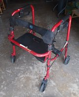 Walker with brakes and a seat in St. Charles, Illinois