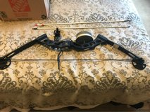 Fishing Bow, laser sight, two arrows. in Fort Riley, Kansas