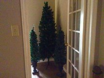 One Christmas Tree and two small lighted trees in Fort Polk, Louisiana