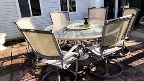 7pc patio set around table and six chairs. in Aurora, Illinois