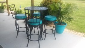 Wrought iron outdoor conversation table set in Baytown, Texas