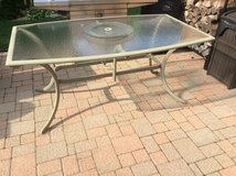 Patio six person glass top table in Plainfield, Illinois