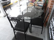 Round Glass Table metal with 4 chairs in Cherry Point, North Carolina