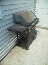 Gas grill with tank in Fort Eustis, Virginia
