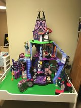 Monster High Castle, 12 dolls, accessories, animal playground, analog clock, and other extras. in St. Charles, Illinois