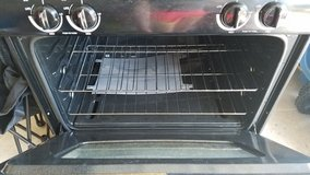 black gas oven and hood in Naperville, Illinois