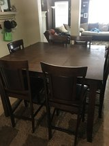 Tall kitchen table and 6 chairs in Conroe, Texas