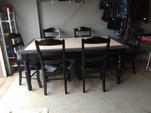 Kitchen table with Corian table top and chairs in Joliet, Illinois