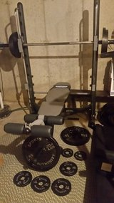 Half smith weight machine with bar, bench and weights- several hook in safety stops in Joliet, Illinois