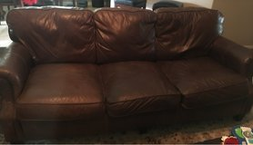 brown leather couch and love seat in Spring, Texas