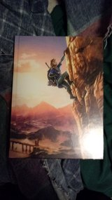 Brand new and sealed The legend of Zelda breath of the wild collectors edition guide in Alamogordo, New Mexico