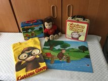 Curious George (set of 5 items) puzzle, shirt, two carry cases & George doll in Ramstein, Germany