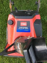 Toro 2450 snow blower starts and runs good very good paddles summer time special in Naperville, Illinois