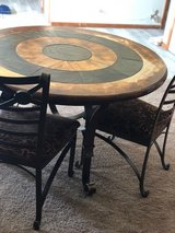 Table with chairs in Oswego, Illinois