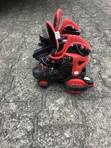 Kids 3 wheeled skates adjustable to size 2 in Ramstein, Germany