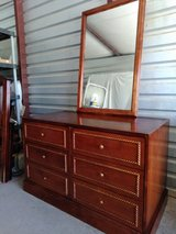 Solid wood dresser with mirror.  Dresser have 6 really huge drawers in Fort Bliss, Texas