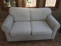 Green and White striped sofa in Glendale Heights, Illinois