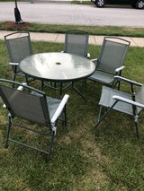 Patio table and folding chairs in Oswego, Illinois