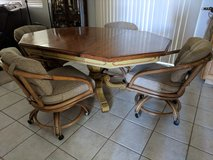 Antique Kitchen Table And Rolling Chairs In Camp Pendleton, California