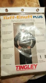 brand new rain suit size L in Baytown, Texas