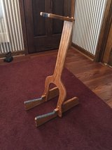 Custom made wooden guitar stand in Chicago, Illinois