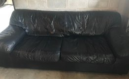 Black Italian leather couch in Fort Campbell, Kentucky