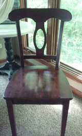 Four Dark-Stained Chairs in Naperville, Illinois