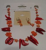 Orange necklace set in Pearland, Texas