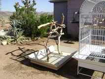 Bird cage and portable perch in Yucca Valley, California
