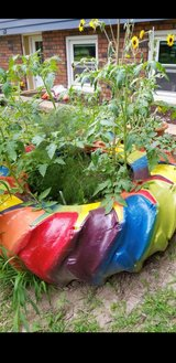 Rainbow painted tractor tire planter in Brookfield, Wisconsin
