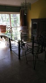 Large glass dining room table in Kingwood, Texas