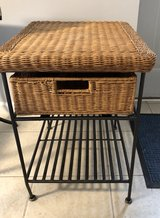 Wicker and iron side table in Schaumburg, Illinois