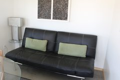 Black soft leather pull out couch. in 29 Palms, California