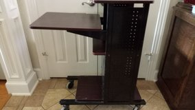 Workstation stand with adjustable shelf in Baytown, Texas