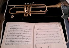 Trumpet with brass mouth piece, case and some sheet music in Bolingbrook, Illinois