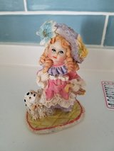 Girl and puppy figurine in Okinawa, Japan