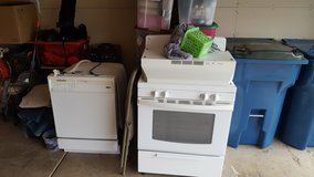 Dishwasher an stove with hood in Lockport, Illinois