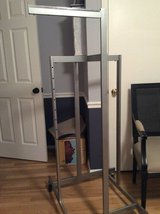 Commercial clothing rack, on wheels, 4 adjustable arms in Fort Belvoir, Virginia