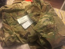 Military 2sets of ocp and 1 winter pts size long large in Jacksonville, Florida